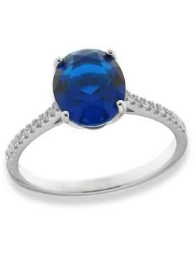 Δακτυλίδι ασημένιο επιπλατινωμένο με άσπρες πέτρες και μπλε ζιργκόν