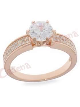 Ασημένιο δαχτυλίδι επιχρυσωμένο ροζ μονόπετρο με μικρές άσπρες πέτρες ζιργκόν στα πλάγια