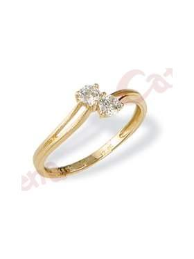 Δαχτυλίδι χρυσό στολισμένο με άσπρες πέτρες ζιργκόν