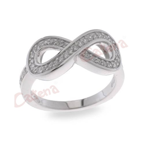 Δαχτυλίδι ασημένιο επιπλατινωμένο με άσπρες πέτρες ζιργκόν σε σχέδιο το  άπειρο. › 276f4d59575